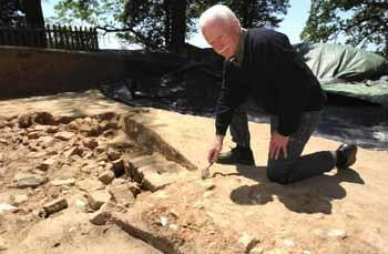 Archaeologist Bill Kelso, director of the Jamestown Rediscovery excavation project, surveys a discovery.