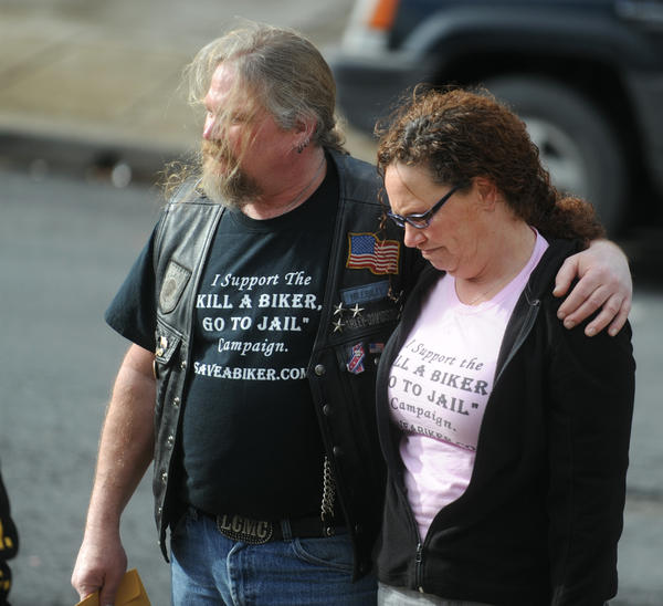 Jerry Hoogmoed, a Last Chance Motorcycle Club member, puts his arm around Renee Capezza, of Warwick, NY, at the Northampton County Courthouse on Monday  after the sentencing of John P. Heaney III on involuntary manslaughter for a fiery wreck that killed two motorcyclists in Bangor.