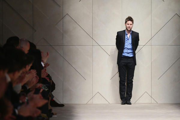 Designer Christopher Bailey acknowledges the applause of the audience after the Burberry Prorsum show as part of Milan Fashion Week Menswear Autumn/Winter 2013 on January 12, 2013 in Milan, Italy.