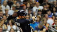 Milwaukee Brewers Jonathan Lucroy, a Umatilla graduate, homering against the Chicago Cubs on Aug. 20, 2012, will play for Team USA in the World Baseball Classic. (Benny Sieu, US Presswire)