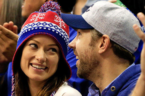 Olivia Wilde and Jason Sudeikis attend a Kansas University basketball game in Lawrence, Kan.