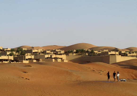 Foreigner tourists standing outside Qasr al-Sarab Hotel (Mirage Hotel) located on the edge of Rub¿ al-Khali (empty quarter) desert south of Abu Dhabi