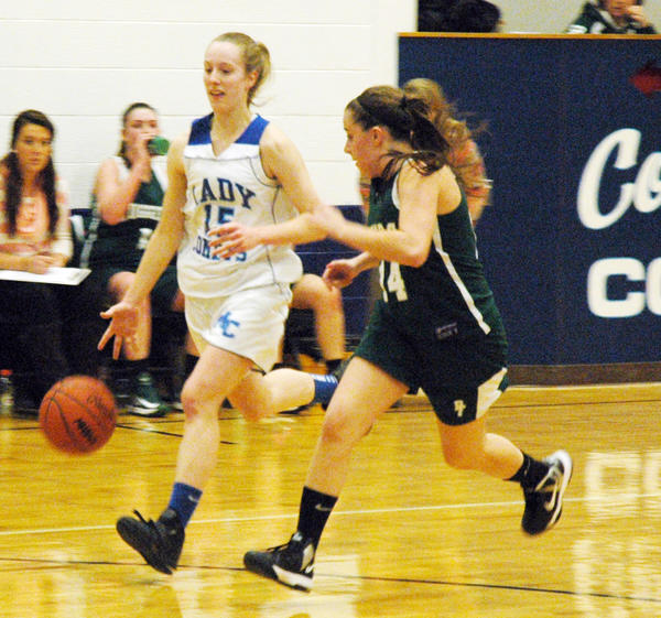 Mackinaw City senior Courtney Wallis (left) pushes the ball upcourt as Boyne Falls junior Kathryn Miller defends during Friday's Northern Lakes Conference contest at the Mackinaw City High School gym.