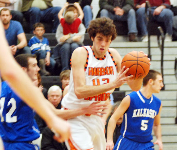 Harbor Springs' Neal Zoerhof cuts to the middle during Friday's Lake Michigan Conference contest agaisnt Kalkaska at the Harbor Springs High School gym.