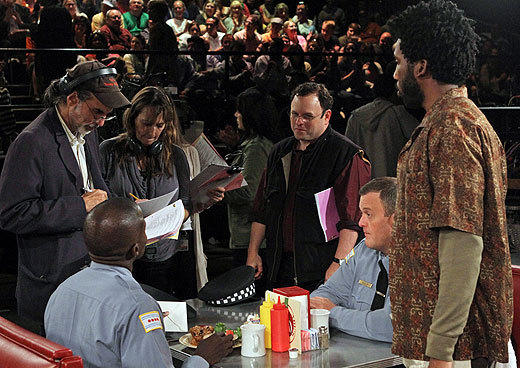 Episode director Jason Alexander (center) huddles with the cast and crew.