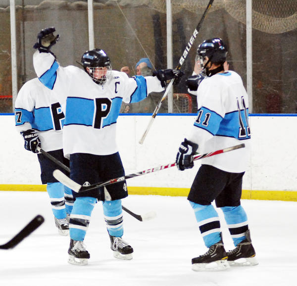 Petoskey senior forward Syke Pieffer (left) celebrates his third period and eventual game-winning goal with Kenny Forton during Saturday's non-league contest at Griffin Arena against the Bay Area Thunder. The Northmen defeated the Thunder, 4-3.