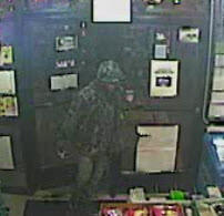 A surveillance photo of an Orland Park armed robbery suspect.