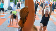 Racing to Om — fitness class combines spinning and yoga