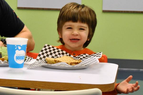 Connor Banks was among the first to enjoy a meal at DuPage Children's Museum's new S.M.A.R.T. Cafe, which opened last week. The Cafe; environment reinforces the healthy lifestyle theme with food packaging, signage and a menu design that allows young children to choose a balanced meal for themselves by using pictures if they can't yet read.