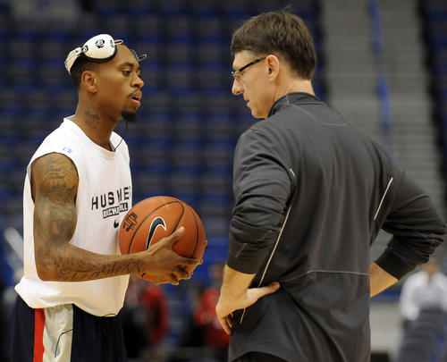 UConn guard Ryan Boatright and associate head coach Glen Miller talk during warmups before the game against Louisville Monday night at the XL Center.