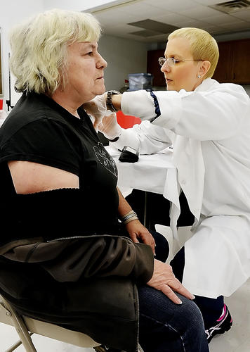 Ruth Hardman gets a flu shot given by Community Health Nurse Diane Narron on Monday at the Washington County Health Department.
