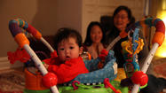 An Evanston couple fighting to adopt a South Korean baby whom they've raised since shortly after her birth was dealt a setback Monday when a federal judge returned authority over the child to U.S. officials, a step toward the child's possible deportation.