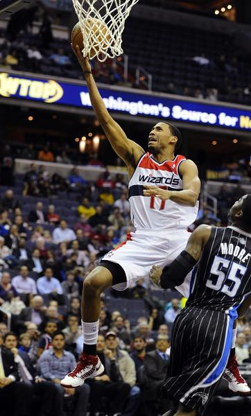Washington Wizards shooting guard Garrett Temple (17) shoots a layup over Orlando Magic shooting guard E'Twaun Moore (55) during the first half at the Verizon Center.