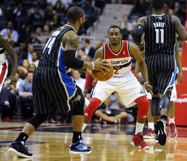 Washington Wizards point guard John Wall (2) defends Orlando Magic point guard Jameer Nelson (14) during the first half at the Verizon Center.