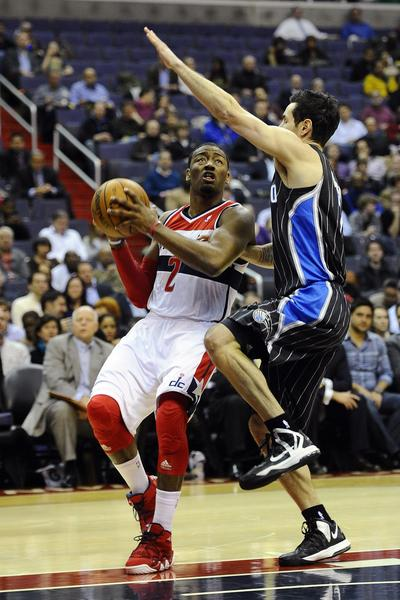 Washington Wizards point guard John Wall (2) drives to the basket as Orlando Magic shooting guard J.J. Redick (7) defends during the first half at the Verizon Center.