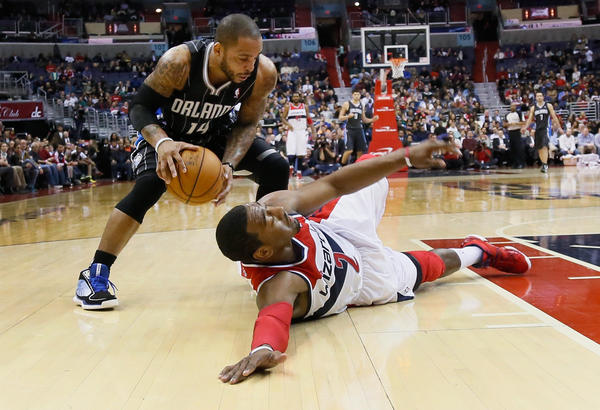 Jameer Nelson #14 of the Orlando Magic picks up a loose ball in front of John Wall #2 of the Washington Wizards during the first half at Verizon Center.