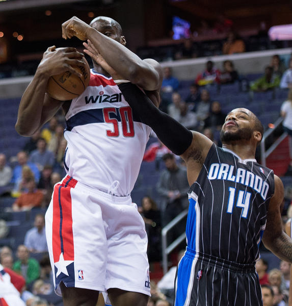 Washington Wizards center Emeka Okafor (50) pulls down a rebound while Orlando Magic point guard Jameer Nelson (14) tries to polk the ball away during the first half of their game played at the Verizon Center in Washington, D.C.
