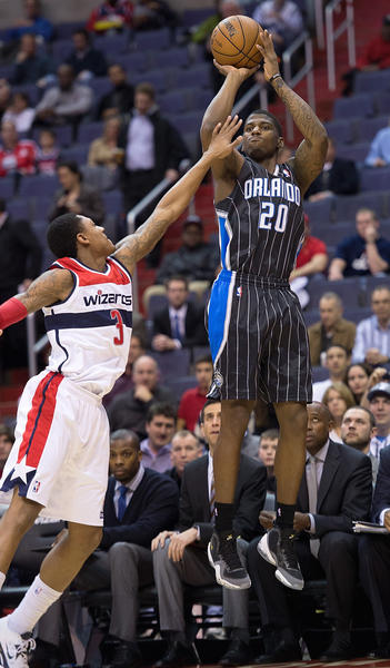 Orlando Magic shooting guard DeQuan Jones (20) shoots over Washington Wizards shooting guard Bradley Beal (3) during the first half of their game played at the Verizon Center in Washington, D.C.