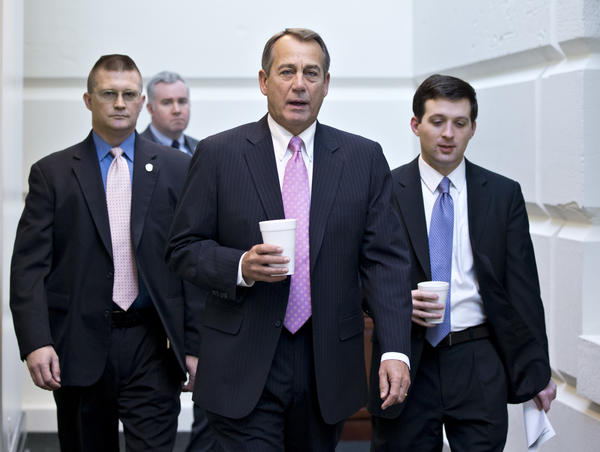 House Speaker John Boehner of Ohio walks to a strategy session with GOP members on Capitol Hill in Washington at the start of the first full day of business for the new 113th Congress.