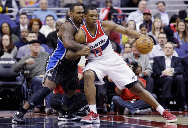 Kevin Seraphin #13 of the Washington Wizards backs into Glen Davis #11 of the Orlando Magic while going to the basket during the first half at Verizon Center.