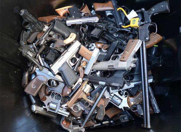 According to James Alan Fox, Northeastern University criminologist, between 1980 and 2010 there were, on average, 20 mass murders a year (defined by the FBI as four or more killings in the same incident) with an average annual death toll of about 100. Above: A trash bin full of handguns collected during the LAPD Gun Buyback Program event on Dec. 26.