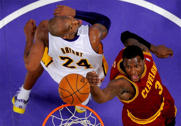 Kobe Bryant forces Cavaliers guard Dion Waiters into an off-balance shot at the rim.