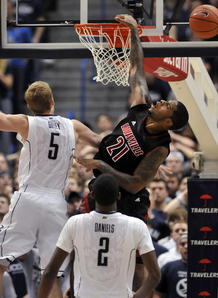 UConn guard/forward Niels Giffey fouls Louisville's Chane Behanan during the second half Monday night at the XL Center. Behanan scored 16 points and grabbed 9 rebounds in a 73-58 Cardinals victory.