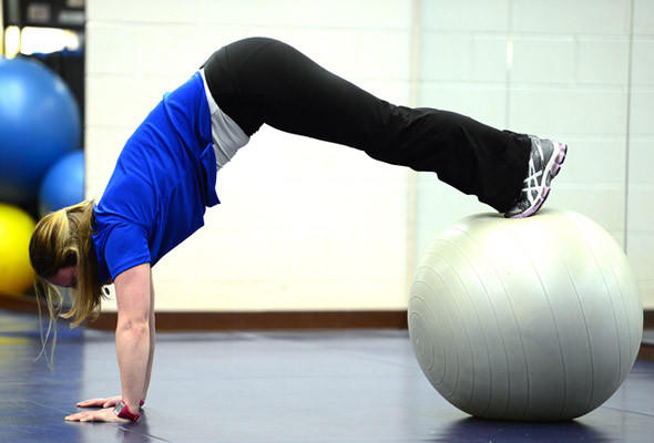 At West End 24/7 Fitness Club personal trainer Jenn Belch demonstrates the stability ball pike with two legs exercise. Balance core training combines strength exercises with acrobatics on an exercise ball to produce a very balanced exercise routine..