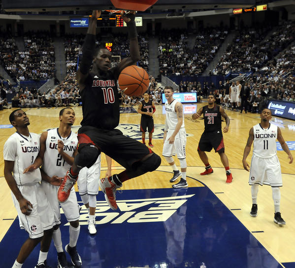 Louisville Cardinals center Gorgui Dieng slams in two of his 6 points against UConn during the second half Monday night at the XL Center. Dieng grabbed 16 rebounds, 12 on the defensive end, to help the Cardinals to a 73-58 victory.