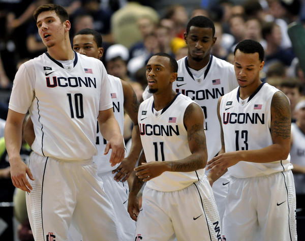 From left, UConn's Tyler Olander, Omar Calhoun, Ryan Boatright, DeAndre Daniels and Shabazz Napier can feel the shift in the game late in the second half as Louisville pressured the Huskies into 17 turnovers in a 73-58 Cardinals victory Monday night at the XL Center.