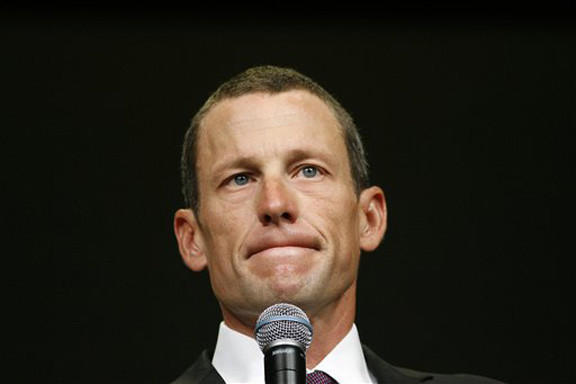 In this 2009 file photo, Lance Armstrong speaks during the opening session of the Livestrong Global Cancer Summit in Dublin, Ireland. Local and international news crews were staking out positions in front of Armstrong's lush, Spanish-style villa ahead of the cyclist's interview with Oprah Winfrey later Monday.