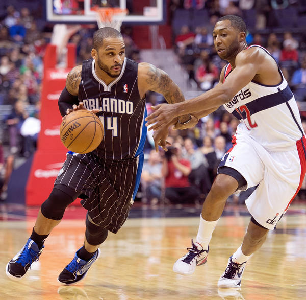 Orlando Magic point guard Jameer Nelson (14) drives to the basket against Washington Wizards point guard A.J. Price (12) during the first half of their game played at the Verizon Center in Washington, D.C.