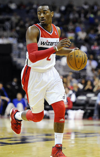 Washington, DC, USA; Washington Wizards point guard John Wall (2) dribbles the ball against the Orlando Magic during the first half at the Verizon Center.
