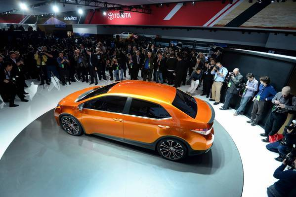 Members of the media view Toyota's Corolla Furia concept vehicle during the 2013 North American International Auto Show in Detroit.