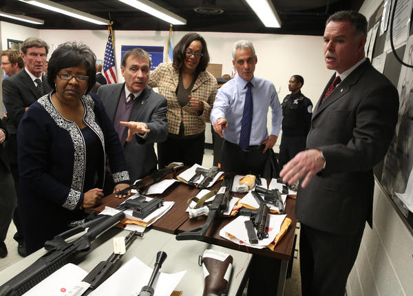 Mayor Rahm Emanuel, along with Chicago police superintendent Garry McCarthy, look over a display of confiscated guns following the announcement of the revitalization of the community policing program last week.