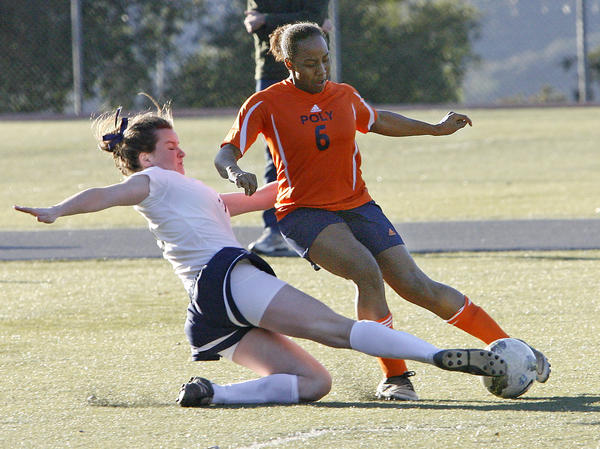 Flintridge Prep's Katherine Pinney sweeps the ball from Pasadena Poly's Noel Askins during a match on Monday, January 14, 2013.