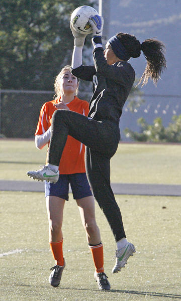 Flintridge Prep goalie Casey Cousineau defends her goal against Pasadena Poly's Kayla Valencia during a match on Monday, January 14, 2013.