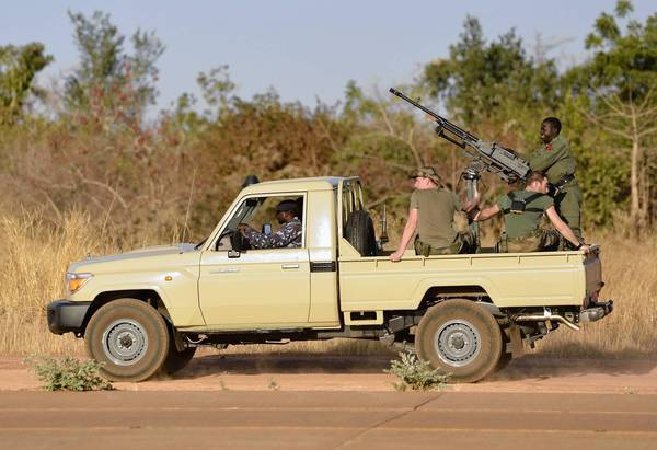 French soldiers deployed in an operation against Islamist militants in Mali ride in a military vehicle at an air base near Bamako, the capital.