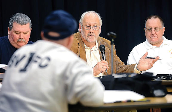 Fairplay Task Force Chairman Paul Miller, center, addresses the task force Monday at Rockland Woods Elementary. At left is Jeb Eckstine, co-chairman, and Charlie Summers, deputy director of the Washington County Department of Emergency Services, is at right.