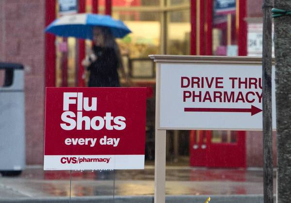 A sign outside of the CVS Pharmacy at Oyster Point Road and Warwick Boulevard advertises flu shots.