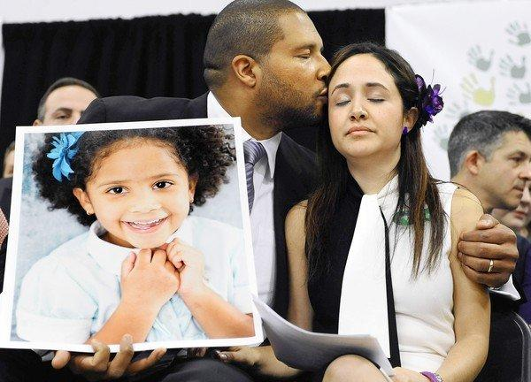 Jimmy Greene and wife Nelba Marquez-Greene with a portrait of their daughter, Sandy Hook Elementary School shooting victim Ana Marquez-Greene.