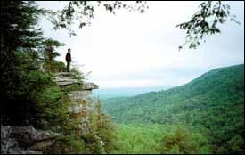 A hiker looks out over the Shawangunk Mountain range.
