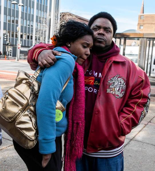 Andras Shaw, right, and Quiona Woods, show support for slain friends Eric Glover and Terrance Rankins, both 22, on Monday at the Will County Courthouse in Joliet.