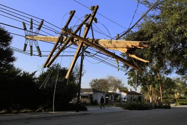Nearly a quarter of a million Southern California Edison customers were without power, some for a full week, after a windstorm toppled utility poles in fall 2011. Above, a downed pole in Temple City.