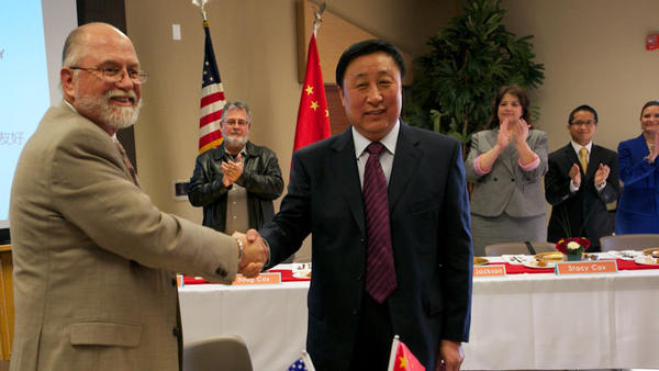 Imperial City Councilman Mark Gran and Dezhou Deputy Mayor Man Chunzhong shake hands after signing a sister city agreement Monday. Officials hope bilateral business investments will increase following the agreement. Dezhou is considered China's solar city for its use of renewable energy.
