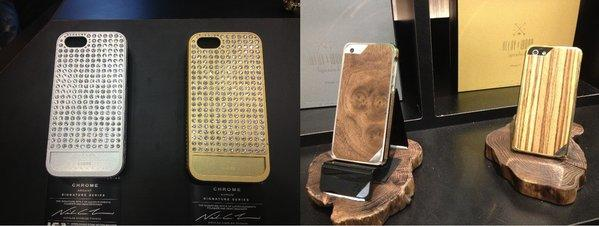 A $750 Swarovski crystal-studded iPhone case from Lucien, left, and a $300 Japanese wood and gold-plated case from Patchworks are displayed at the Consumer Electronics Show.