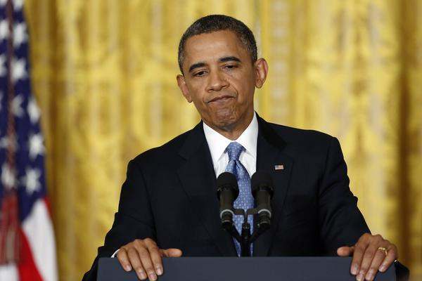 President Barack Obama pauses during remarks at a news conference at the White House in Washington, January 14, 2013.