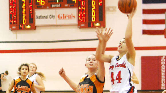 J-L senior Katie Kierczynski swoops to the hoop during Friday¿s 59-7 victory against Mancelona. After a victory Monday at Mio, the Cardinals are now 10-0 on the season.