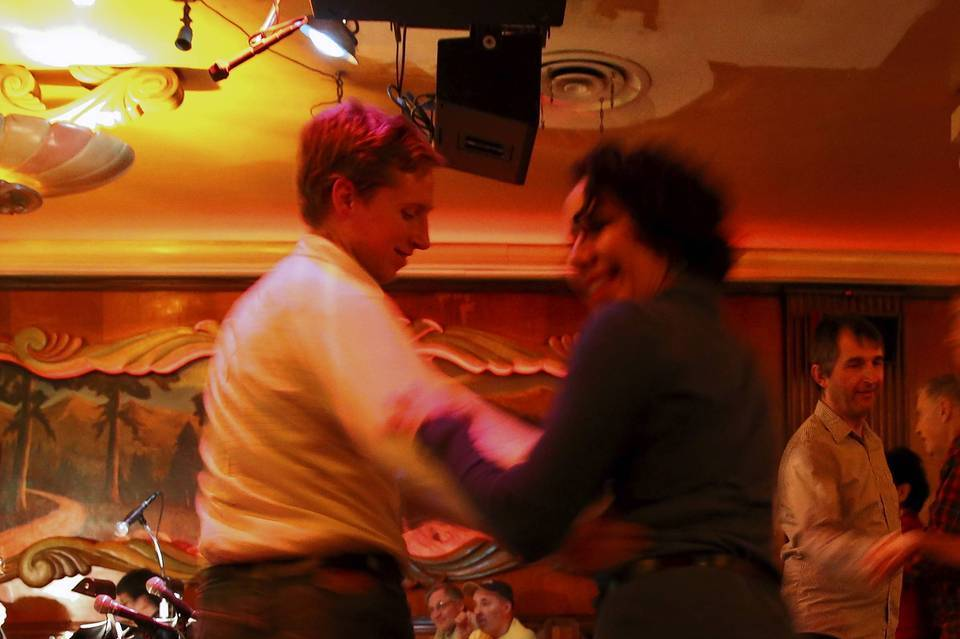 Couples dance as The Fat Babies perform at the Green Mill.