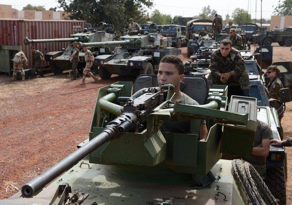 French soldiers ride armored vehicles and tanks Tuesday at a military airbase near Bamako, Mali's capital.